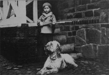 my husband with his dog and a toy rifle 1933 - Hidden Pictures For Children